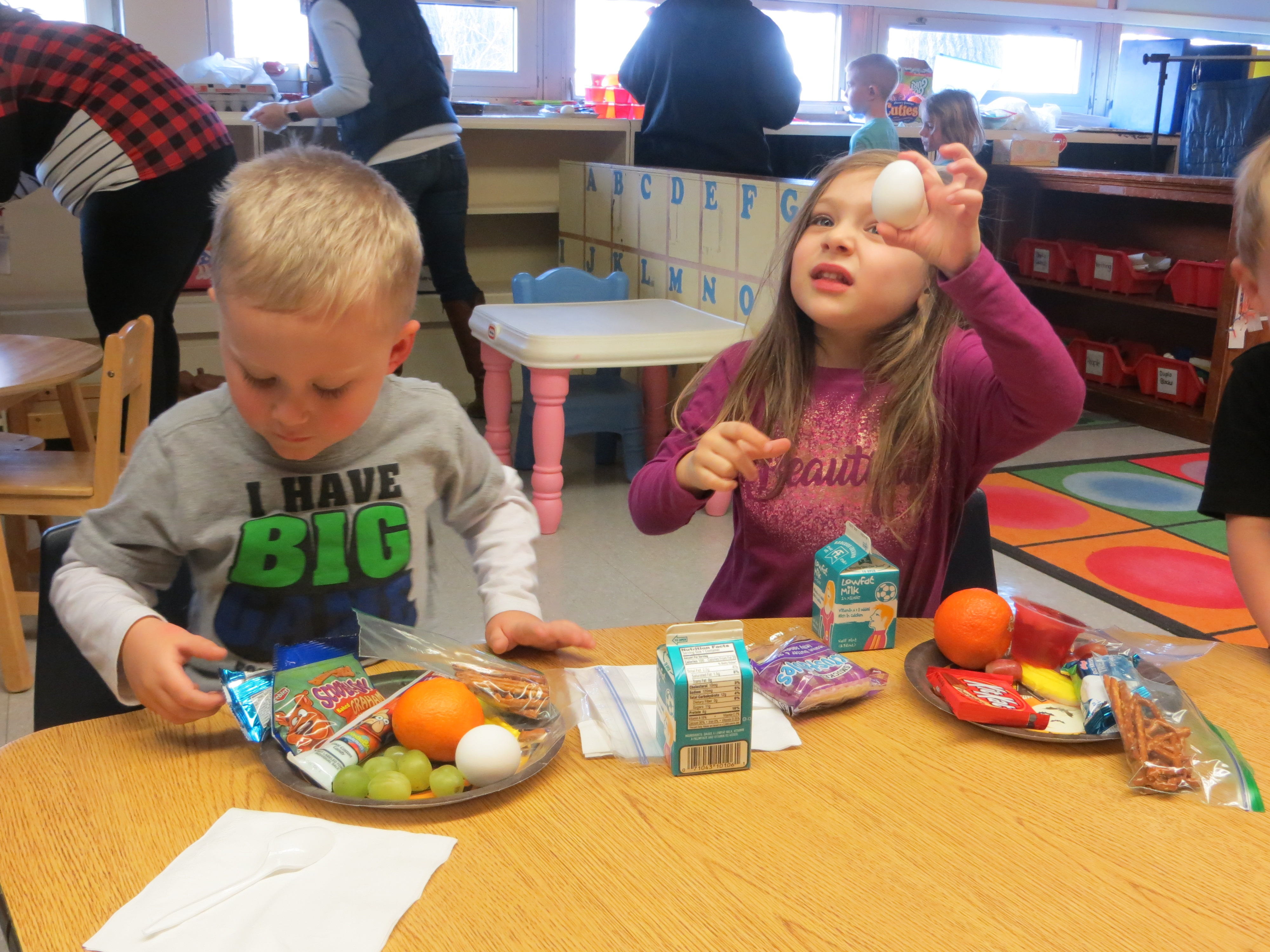 Preschool students having fun at their alphabet party