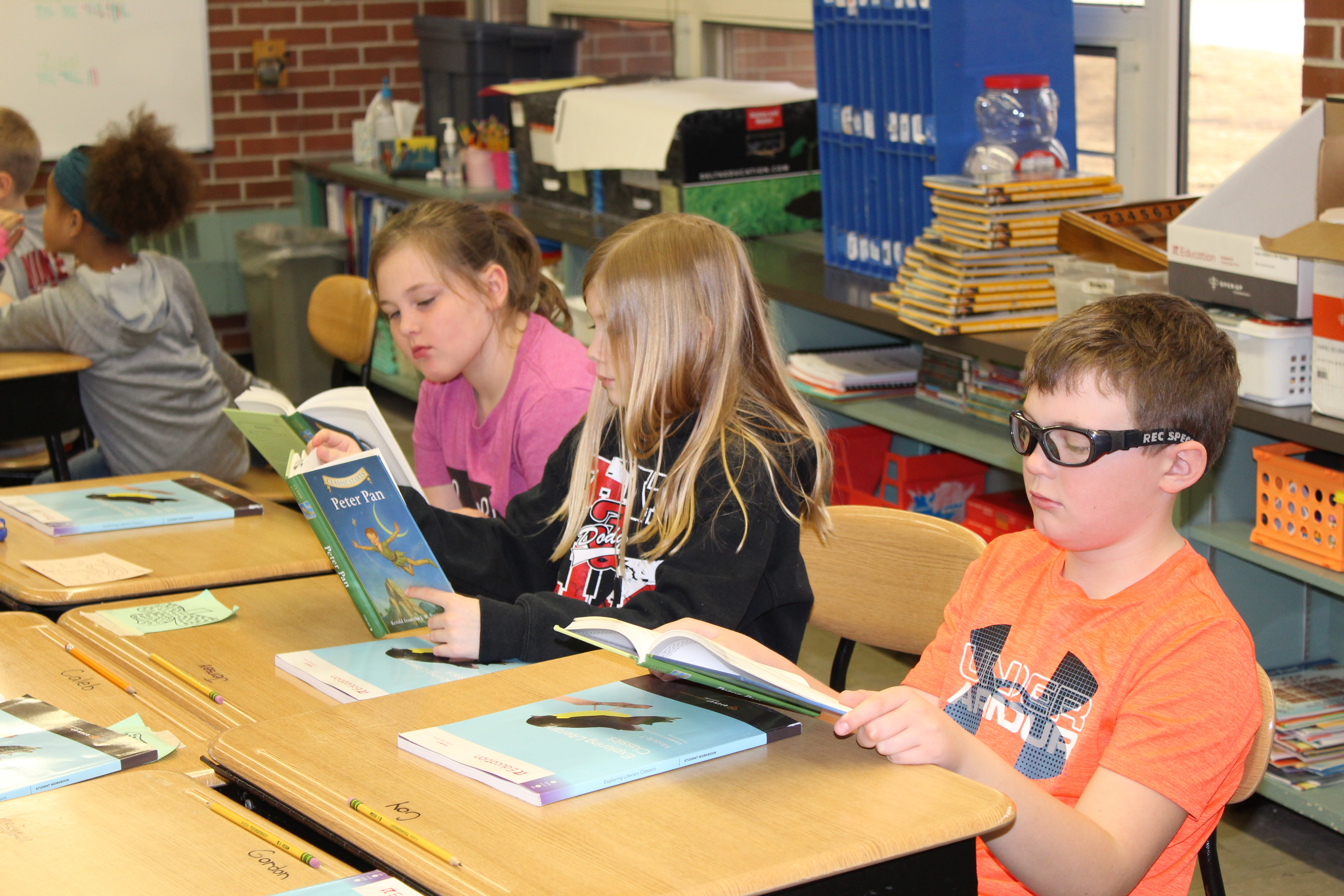 students reading at desks