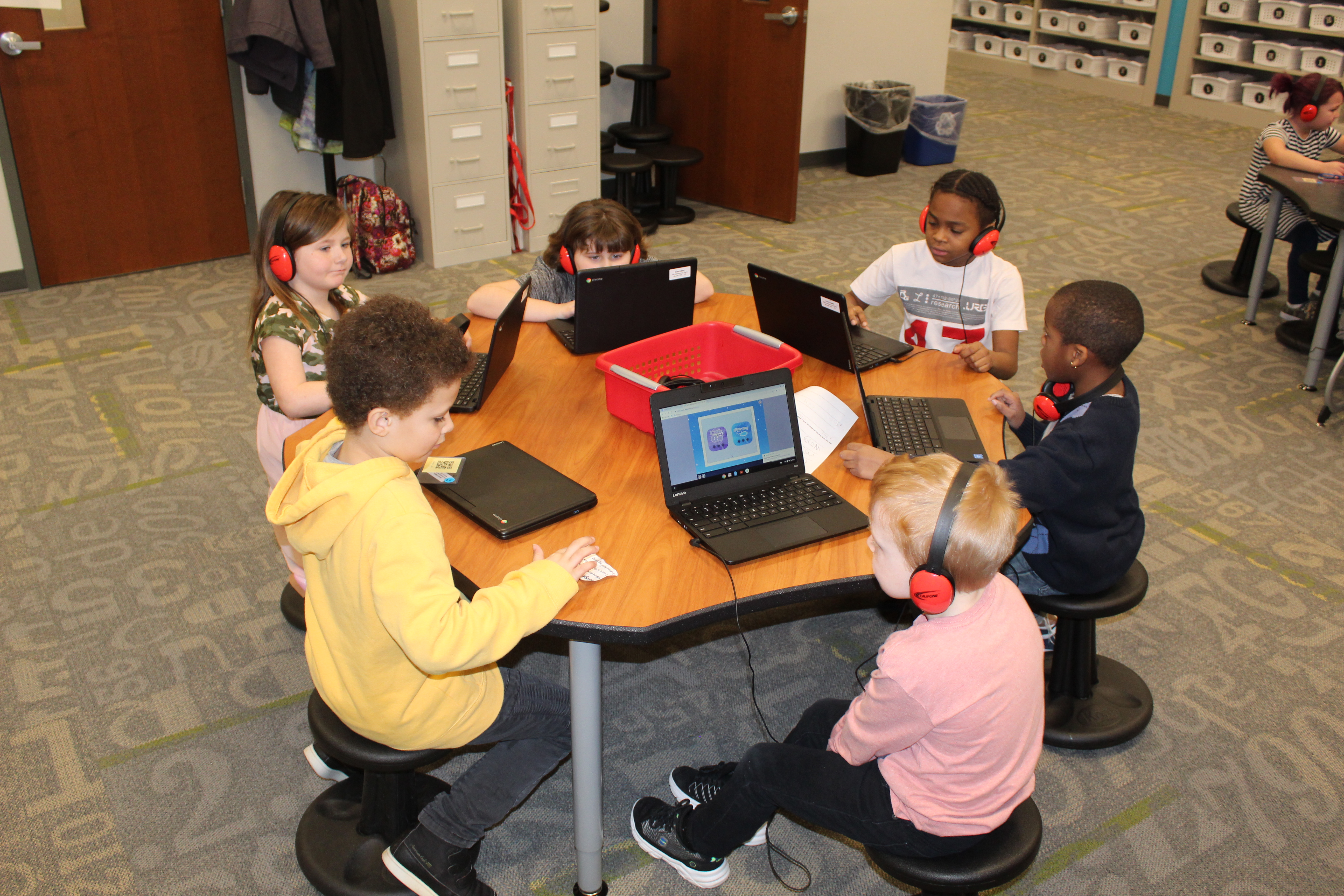 students using chromebooks at table
