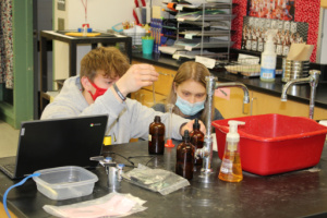students conducting chemistry lab