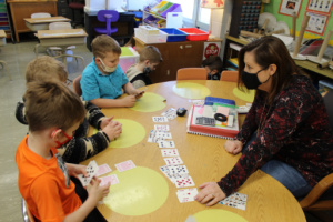 students using cards to practice addition skills to 10