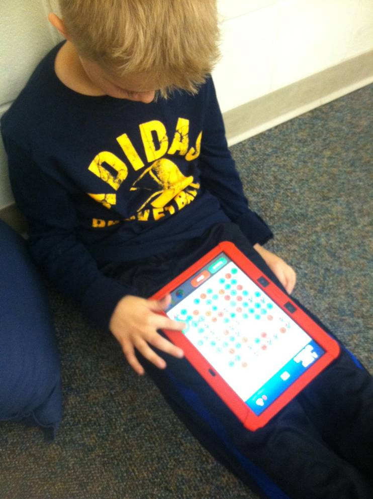 student plays an educational app
