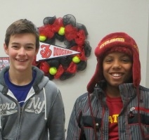 2 boys standing in front of black and red Dodger wreath